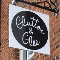 Glutton & Glee's gleeful logo