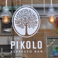 The Pikolo Espresso Bar, with it's logo of a tree in the window on Park Avenue, Montreal