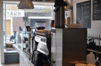 The counter at Store Street Espresso, looking back towards the front window.
