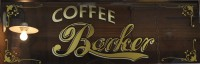 The Coffee Barker sign, written on one of the windows.