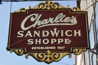 Charlie's Sandwich Shoppe sign hangs proudly over the sidewalk on Columbus Avenue