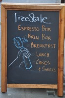 The A-board outside FreeState Coffee: Espresso Bar, Brew Bar, Breakfast, Lunch, Cakes & Sweets