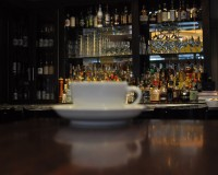 My cup of coffee surveys the bar at the back of the South End Buttery