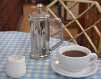 Coffee at the Plan: a plunged and poured cafetiere of Peter James' finest Columbian with an entirely superfluous jug of milk.