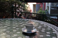 An espresso on one of the tables in the garden at the back of the Boston Tea Party, Park Street, Bristol