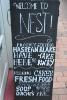 The A-board at Nest on Kensington Gardens, promising Has Bean's Blake Blend, delicious cakes and fresh food.