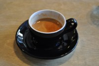 An amazing Has Bean espresso, the Candy Cane blend, in a classic black cup from South Coast Roast.