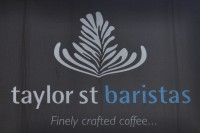 The Taylor Street Baristas since, with its emblem of a latte-art leaf