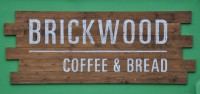 The Brickwood Coffee & Bread sign from the front of the shop on Clapham Common