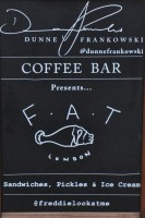 "The A-board, proudly announcing the Dunne Frankowski Coffee Bar's collaboration with F.A.T: ""Sandwiches, Pickles & Ice Cream"""