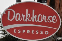 The Darkhorse Espresso sign, white writing on a red oval.