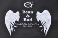 "The Bean & Bud logo: a coffee bean flanked by two tea buds, with the motto ""Bean & Bud Real Coffee & Fine Tea since 2010"""