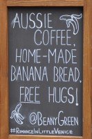 One of Beany Green's A-boards, promising Aussie Coffee, Home-made Banana Bread and FREE hugs!