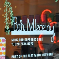 Milk Bar, with the name written in Polish in the window. Naturally.