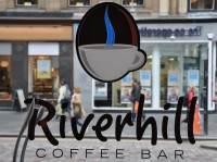 The writing in the window of the Riverhill Coffee Bar (reversed)