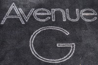 "The words ""Avenue G"" in white on black."