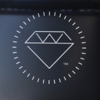 The Workshop logo, a diamond inside a circle.