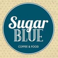 "The Sugar BLUE logo: ""Sugar BLUE"" with ""COFFEE & FOOD"" underneath, written in a blue circle."