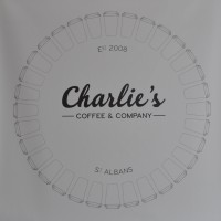 Charlie's Coffee & Company, surrounded by a circle of coffee cups (lids outward)