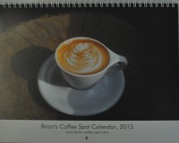 The cover of the Brian's Coffee Spot Calendar, 2015, showing a flat white in a white cup, with tulip latte art