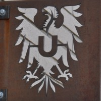 The Ultimo symbol, a Roman Eagle, here cut out of an iron plate.
