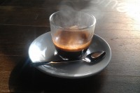 An espresso in a glass, steaming in the sunlight streaming through Brewsmith's window.