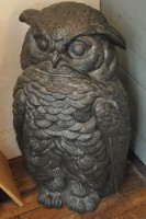 A carved owl in the corner between counter and door at Télescope in Paris.