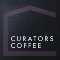 The Curators Coffee sign.