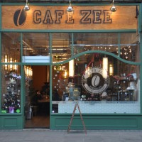 The front of Cafe Zee on Ealing's New Broadway. The roaster can be seen at the back through the door.