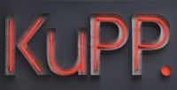 The KuPP logo in red neon.