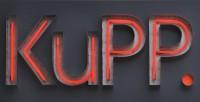 The KuPP logo in red neon.