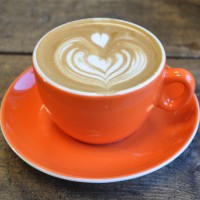A lovely flat white in an orange cup from Upshot Espresso in Sheffield