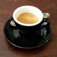 A decaf espresso in a classic, black cup (with white interior), served at Tamper's Westfield Terrace branch, Sheffield.
