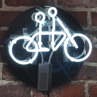 A light bulb in the shape of a tandem bicycle from the wall of the Tandem Coffee Roasters Roastery