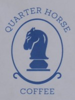 "The Quarter Horse Coffee logo: a profile of a knight from a chess set, surrounded by an oval with the words ""Quarter Horse Coffee"" written around the outside."