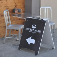 The A-board outside Street Bean Coffee on Seattle's 3rd Avenue, pointing the way inside.