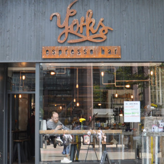 The front of Yorks Espresso Bar, at the northern end of Birmingham's Great Western Arcade. The door is on the left, and the window-bar is clearly visible through the window to its right.