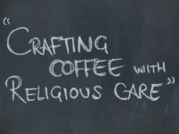"From a black board behind the counter at Saint Espresso: ""Crafting Coffee with Religious Care""."