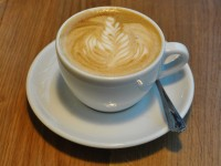 A lovely flat white in a classic white cup, complete with impressive latte-art at Notes at Crossrail Place.