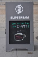 "The A-board outside Slipstream in Washington DC, which poses the question: ""How do we take our Coffee?"". The answer, of course: ""seriously, very seriously""."
