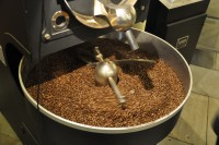 Freshly-roasted coffee beans cooling in the pan of Ancoats' Giesen roaster.