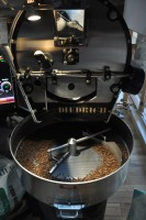Avenue Coffee's Diedrich roaster, with a batch of freshly-roasted beans in the cooling pan.