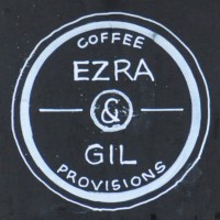 "The Ezra & Gil motto ""Coffee & Provisions"" from one of the signs outside."