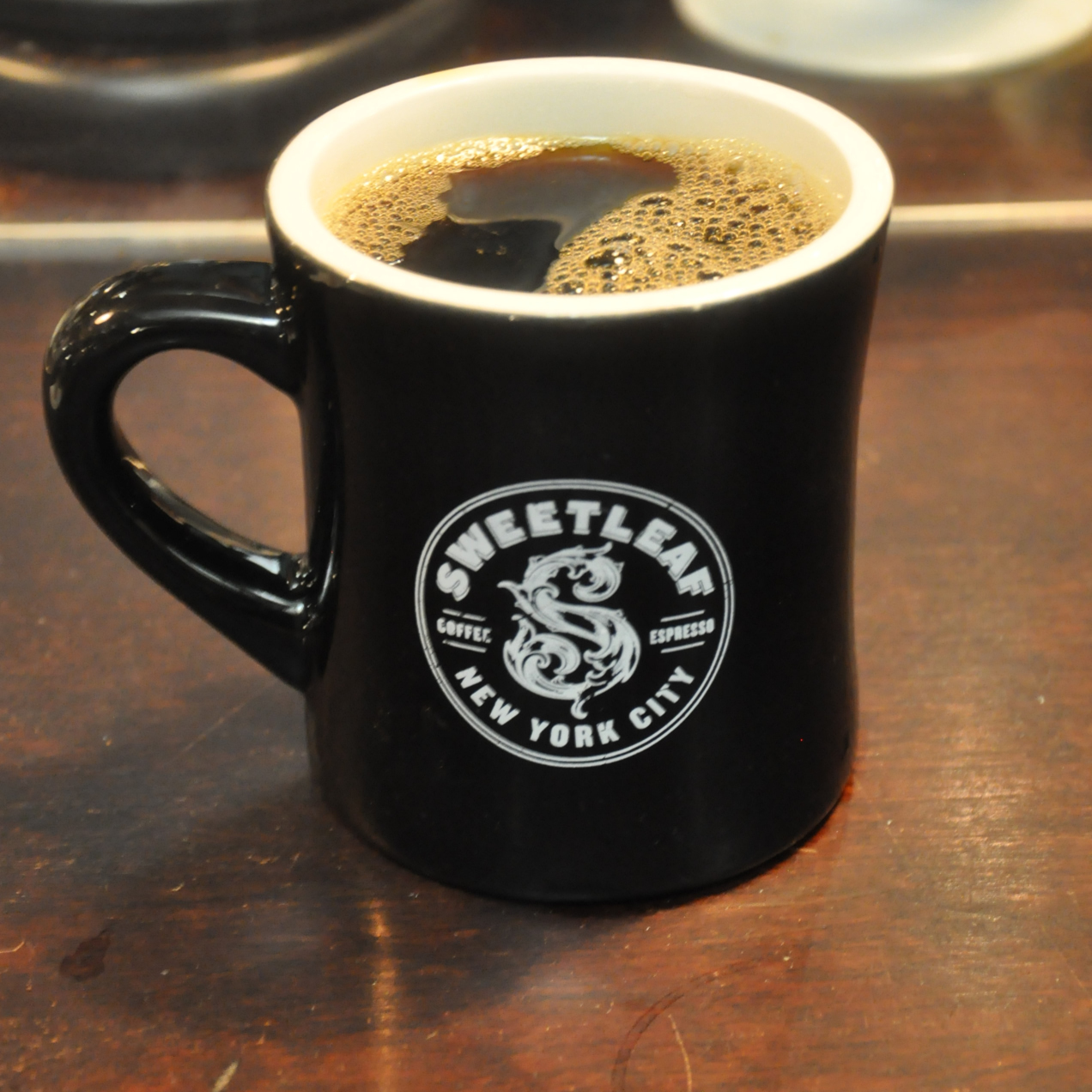 A Mug Of Black Filter Coffee In Clic American Diner Adorned With