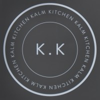 "The Kalm Kitchen logo, the words ""Kalm Kitchen"" written five times around the circumference of a circle, with the letters ""K.K"" in the centre, all in white on grey."