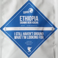 "The label from Neighbourhood Coffee's Ethiopia Sidamo Deri Kocha single-origin coffee, with the catchy name ""I Still Haven't Ground What I'm Looking For""."