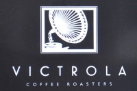 The Victrola Coffee Roasters logo, showing a black-and-white line drawing of the 1920s phonograph after which Victrola is named.