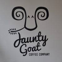 The Jaunty Goat logo, painted on the wall to the left as you enter the store in Chester.