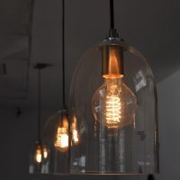 Light bulbs, hanging in glass lampshades, above the counter at Roasted Brown, Dublin.
