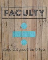 "A series of vertical wooden boards with the words ""Faculty"" and ""speciality coffee & tea"" written horizontally across them, with a blue division sign in the centre."